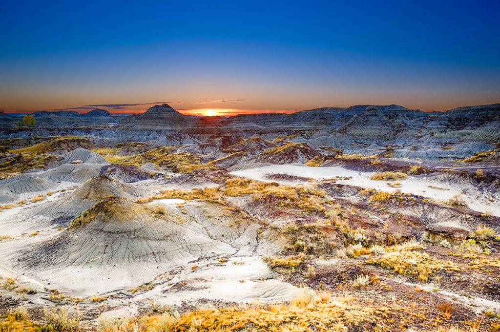 First rays of sun popping up over the horizon at Dinosaur Provincial Park