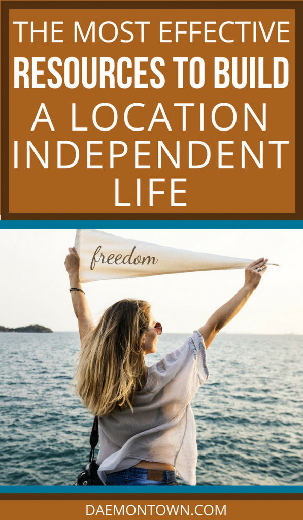 How to become a Digital Nomad- Photo of a woman facing the ocean holding a flag that says freedom over her head.