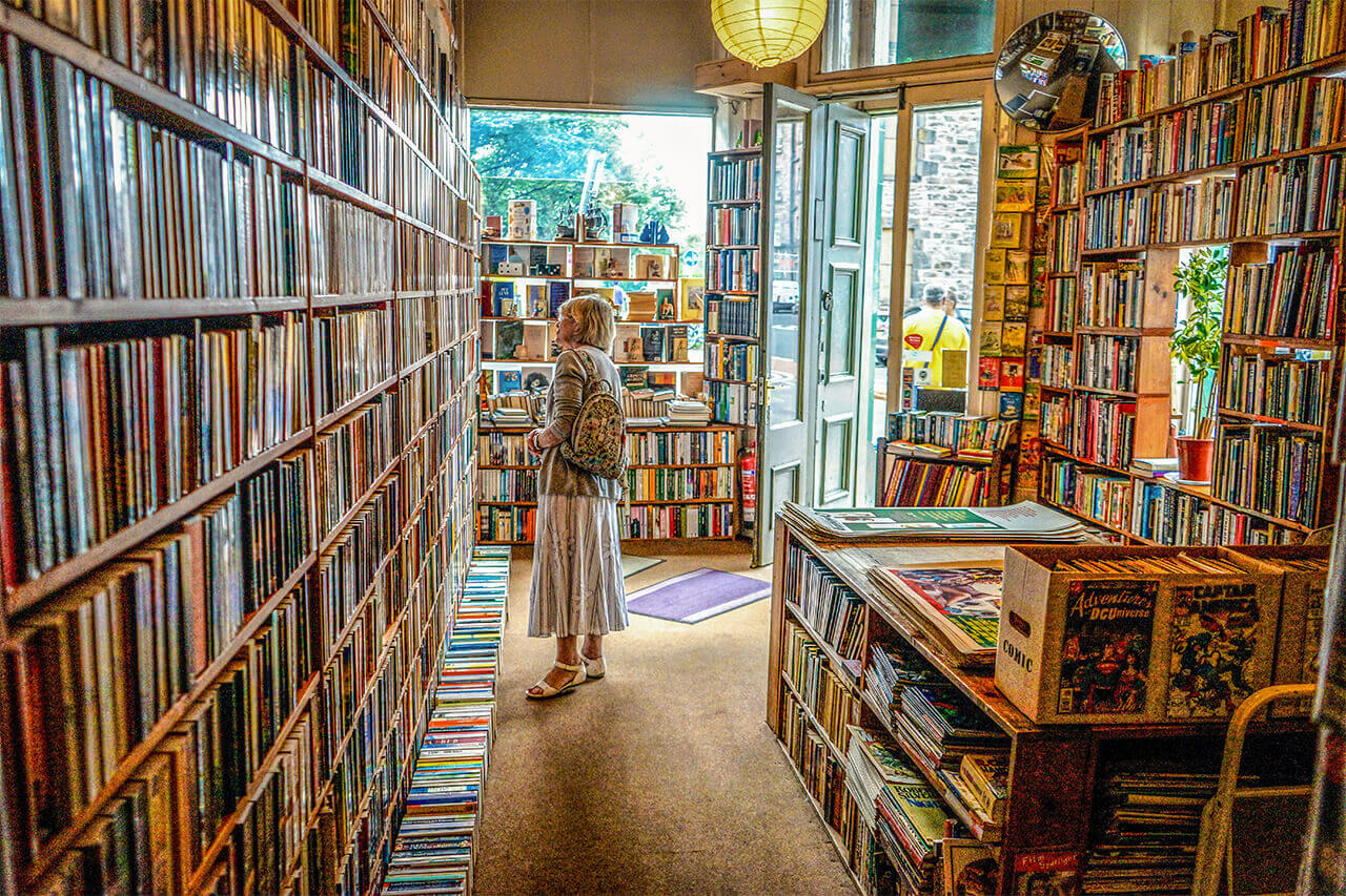 Women shopping for books in a bookstore